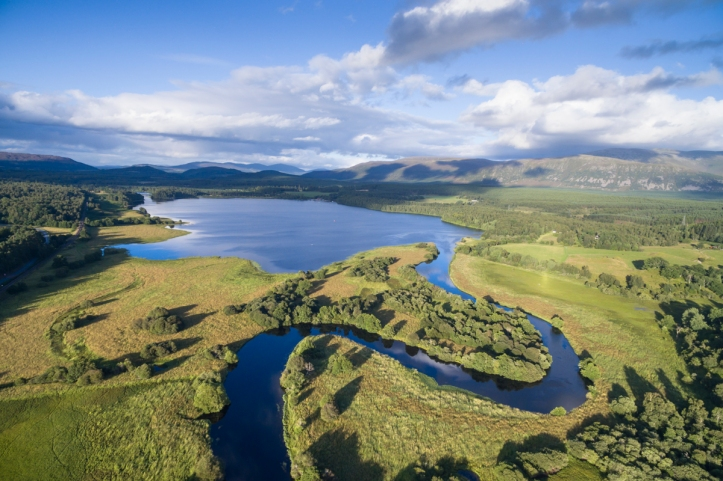 Meander of the River Spey as it leaves Loch Insh in the Cairngorms National Park. Aerial (drone) shot for SCOTLAND: The Big Picture. © James Shooter